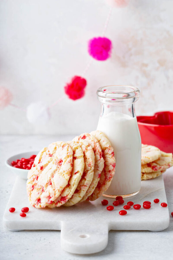 Red Hot Cookies: these Valentine's Day Cookies start with a soft chewy sugar cookie that is loaded with crushed Red Hot Candies to create a speckled appearance. #RedHotCookies #SugarCookies #ValetinesDayCookies #ValentinesDayDessert #ValentinesDay #RedHots