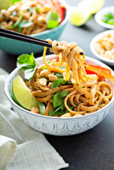 Spicy Peanut Noodles being picked up by chopsticks.