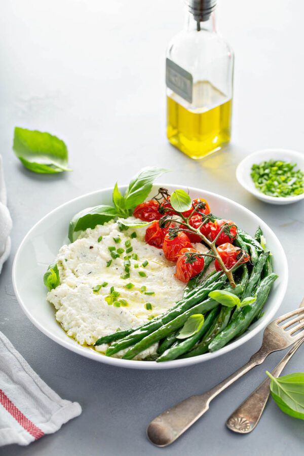 Mashed Cauliflower with roasted green beans and tomatoes.