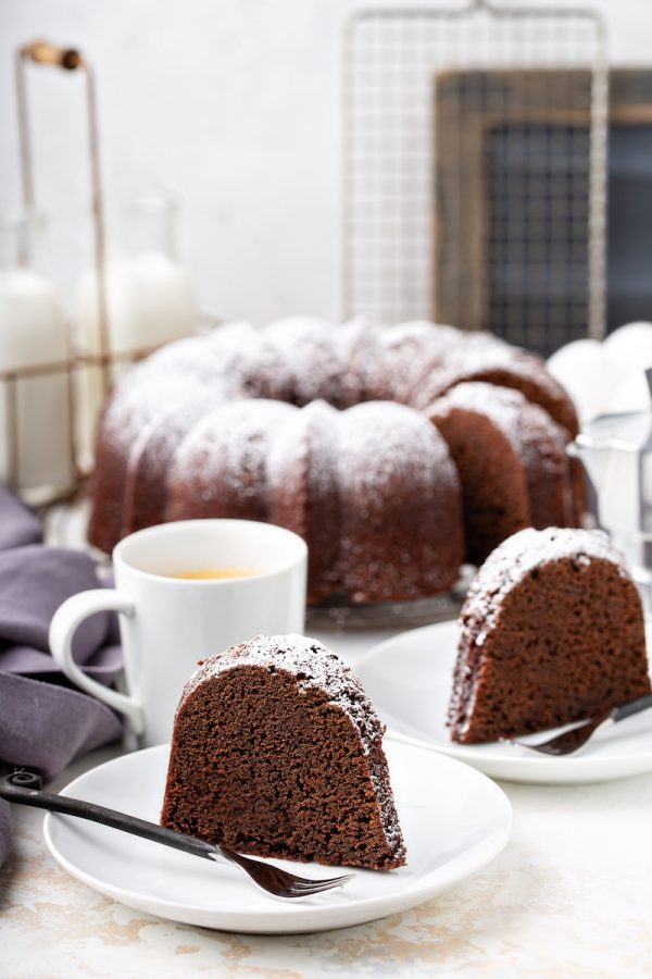 Slices of root beer pound cake on plates.