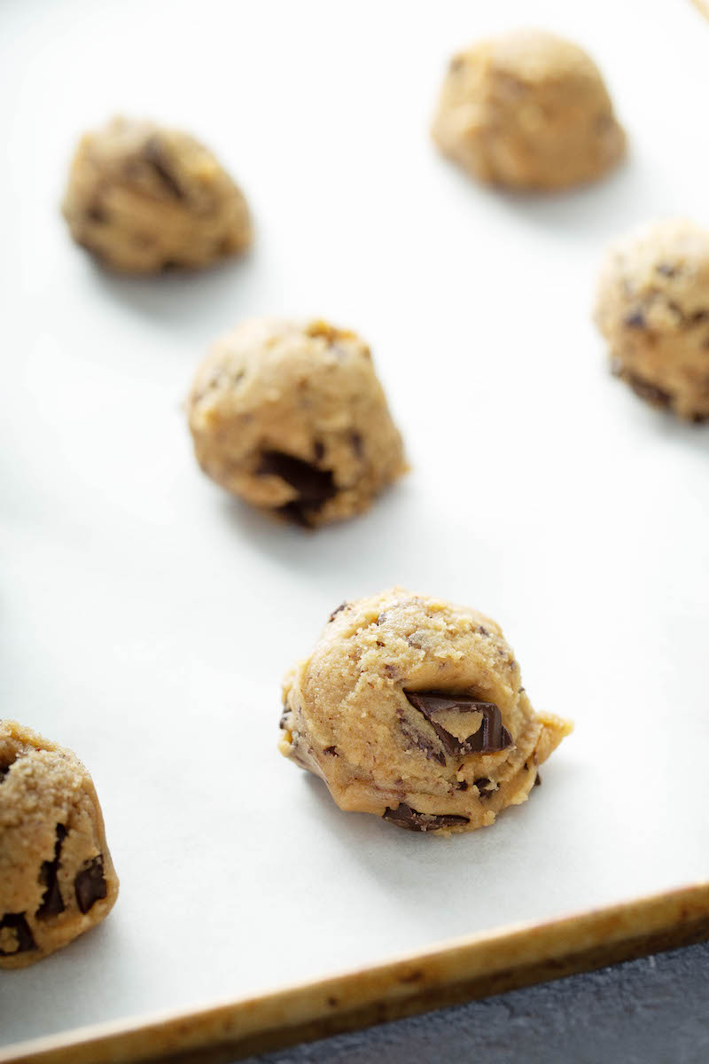 Chocolate Chunk Cookies dough balls on baking sheet