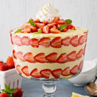 One large trifle bowl filled with a lemon strawberry trifle.