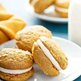 Carrot Cake Whoopie Pies with Cream Cheese Filling on a plate.