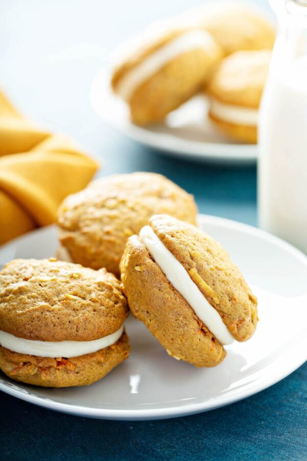Carrot Cake Whoopie Pies With Cream Cheese Filling On A Plate