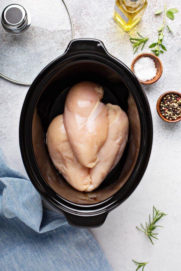 Chicken breasts in a crockpot.