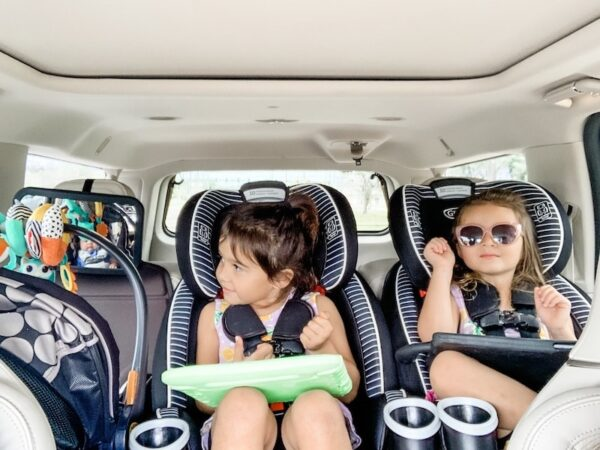 Three kids in car seats.