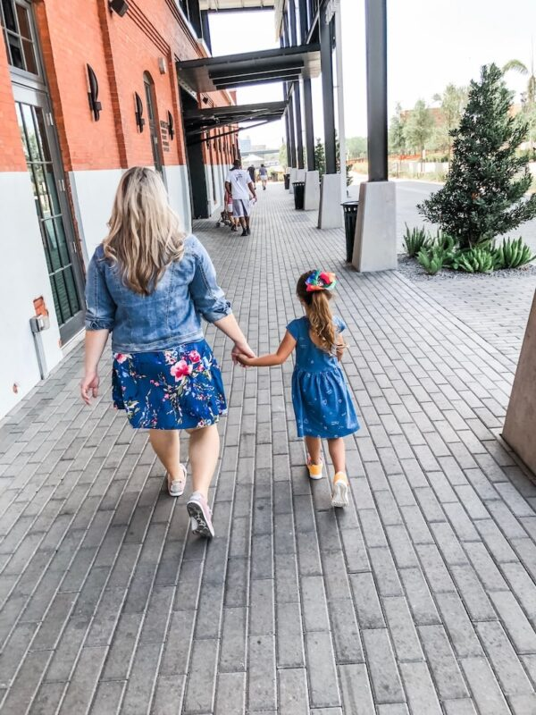 mother and daughter walking holding hands