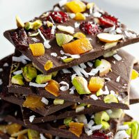 Six Pieces of Dark Chocolate Nut Bark Stacked on Top of One Another