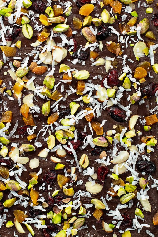 Close up of dark chocolate bark with dried fruit and nuts.