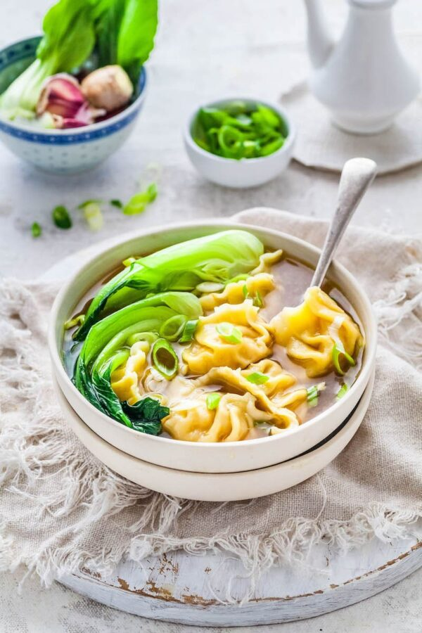 Wonton Soup Recipe in a white bowl with bok choy.
