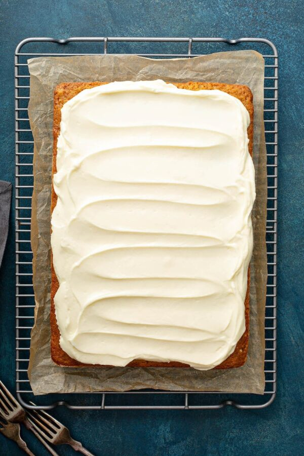 Banana Pecan Cake with creamed cheese frosting spread on top.