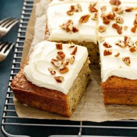Banana Pecan Cake with a slice cut out of it.