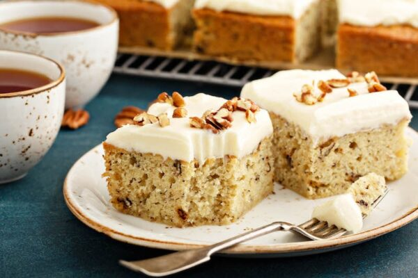 Two slices of Banana Pecan Cake with a fork.