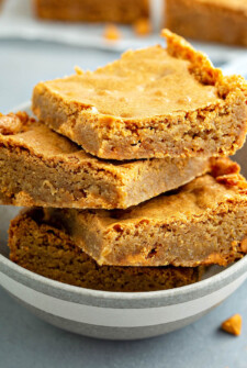 Butterscotch Blondies stacked on top of each other.