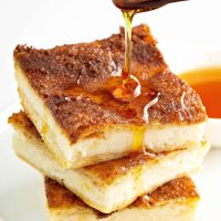 Sopapilla Cheesecake drizzled with honey.