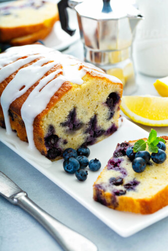 Blueberry Buttermilk Bread sliced on a plate.