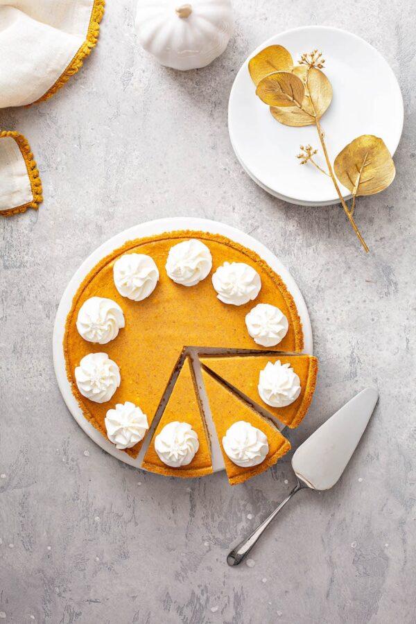 Pumpkin Pie Cheesecake sliced into pieces.
