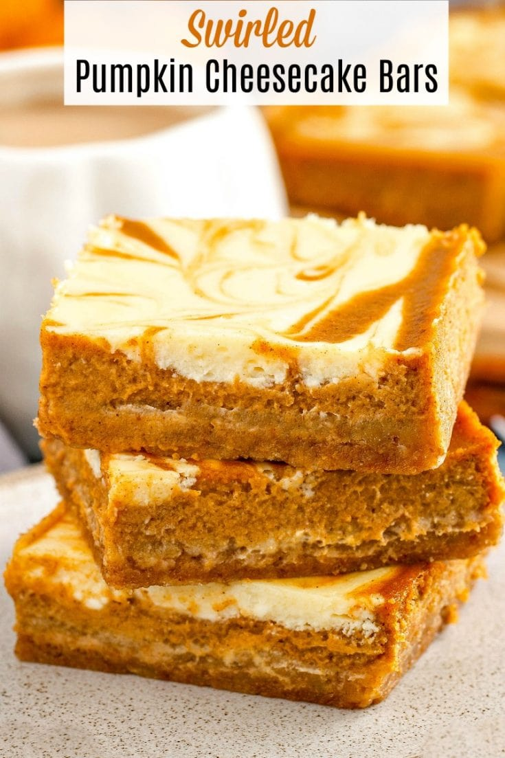 These amazing Swirled Pumpkin Cheesecake Bars have a buttery graham cracker crust, spiced pumpkin pie filling and a sweet, thick cheesecake swirled through them! #Pumpkin #PumpkinCheesecake #PumpkinCheesecakeBars #PumpkinBars #SwirledPumpkinCheesecakeBars #PumpkinDessert #FallDessert #PumpkingPie #PumpkinRecipes #FallRecipes