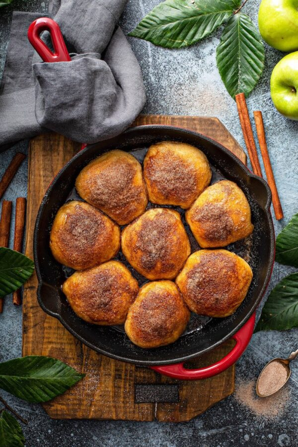Apple pie bombs in a cast iron skillet.