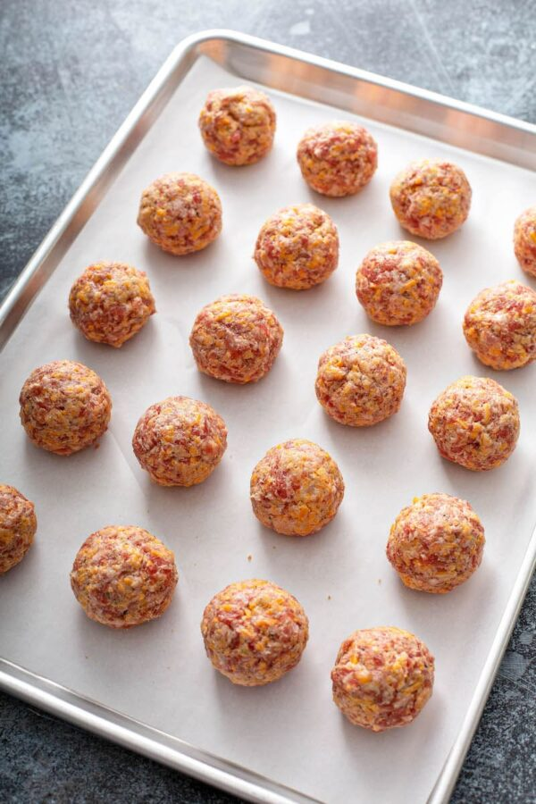 Bisquick Sausage Balls before baking on a cookie sheet.