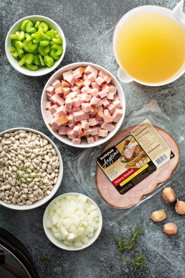 Ingredients for Slow Cooker Ham and Bean Soup in bowls.
