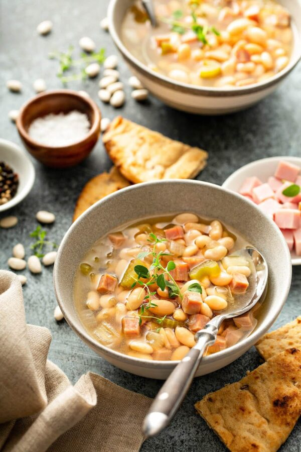 Slow Cooker ham and bean soup in a bowl with a spoon.