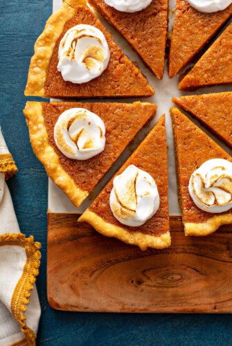 Sweet Potato Pie sliced with marshmallow icing.