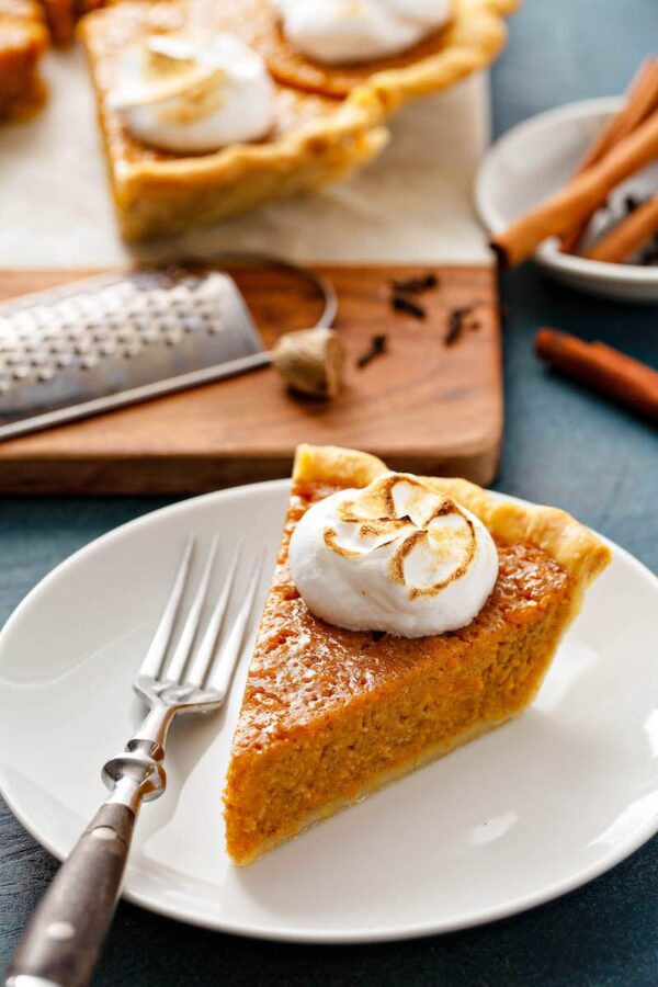 A slice of Sweet Potato Pie recipe on a white plate.