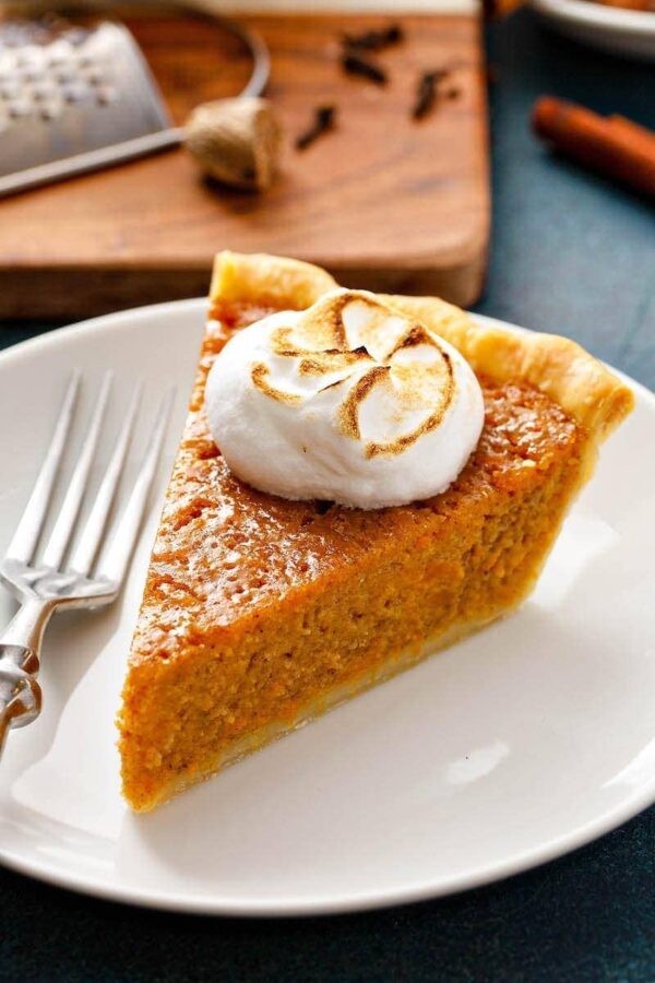 Slice of sweet potato pie with marshmallow on top.