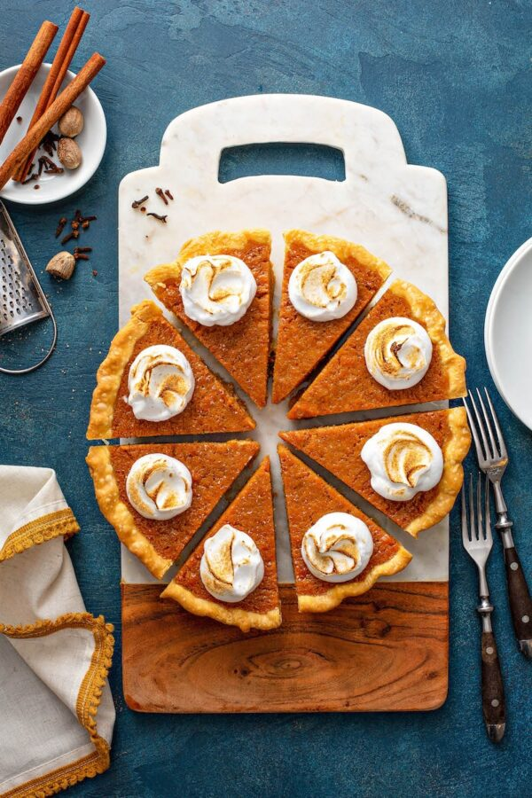 Slices of the best Sweet Potato Pie recipe on a cutting board.