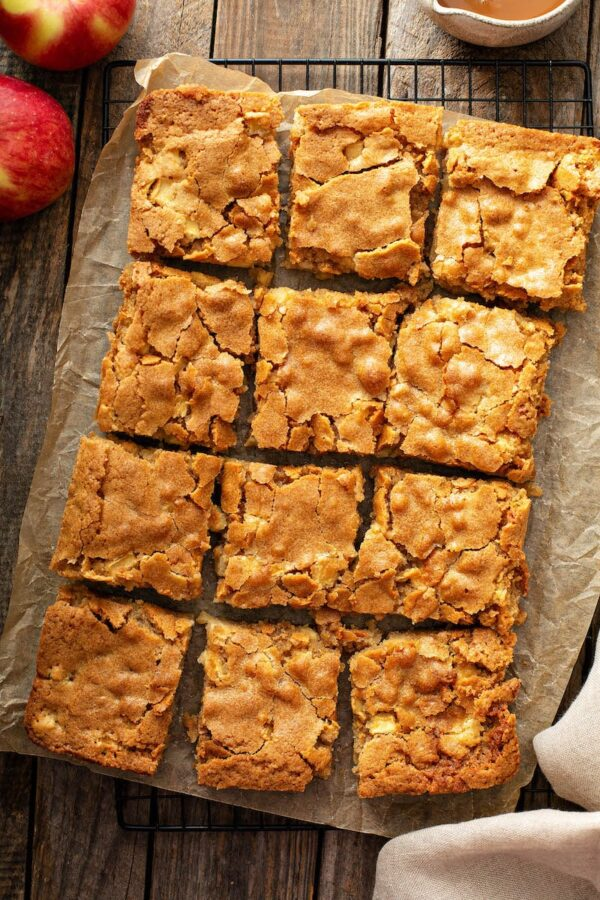 Apple Blondies on parchment paper and cut into squares.