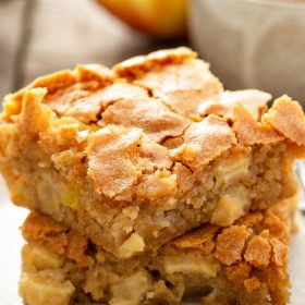These chewy Apple Blondies are loaded with fresh apples, cinnamon, and nutmeg in each bite. Serve them warm with a scoop of vanilla ice cream and caramel sauce! #AppleBlondies #Blondies #Apples #BlondieRecipes #AppleRecipes #Dessert #DessertRecipes #FallRecipes #Recipe