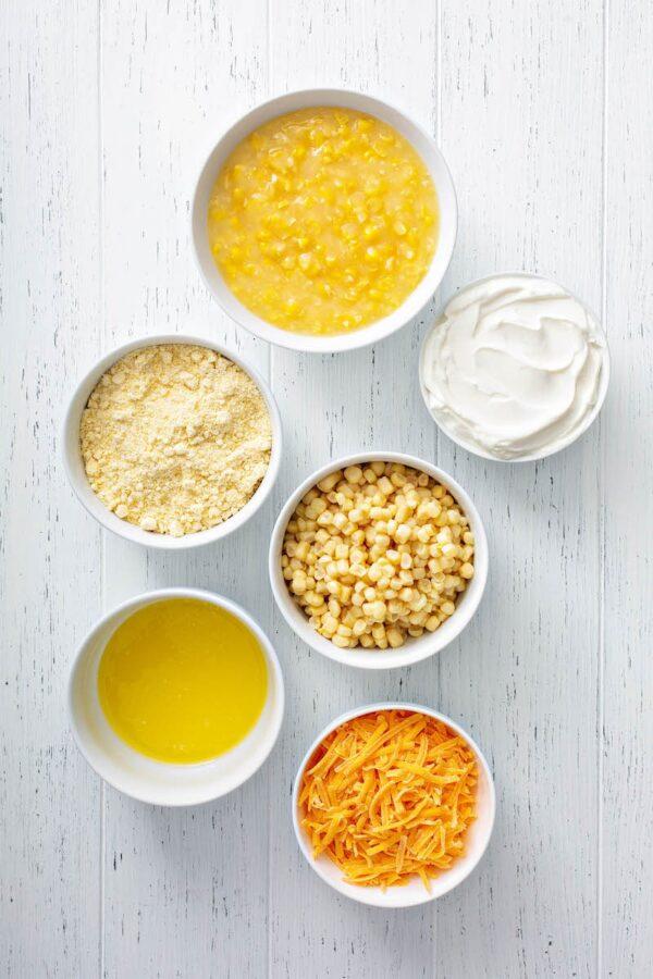 Corn Casserole recipe ingredients in white bowls.