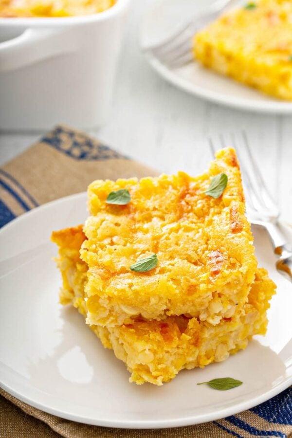 Corn Casserole Recipe on a white plate.