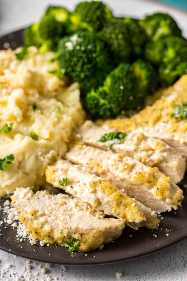 Creamy Parmesan Chicken on a plate sliced into pieces.