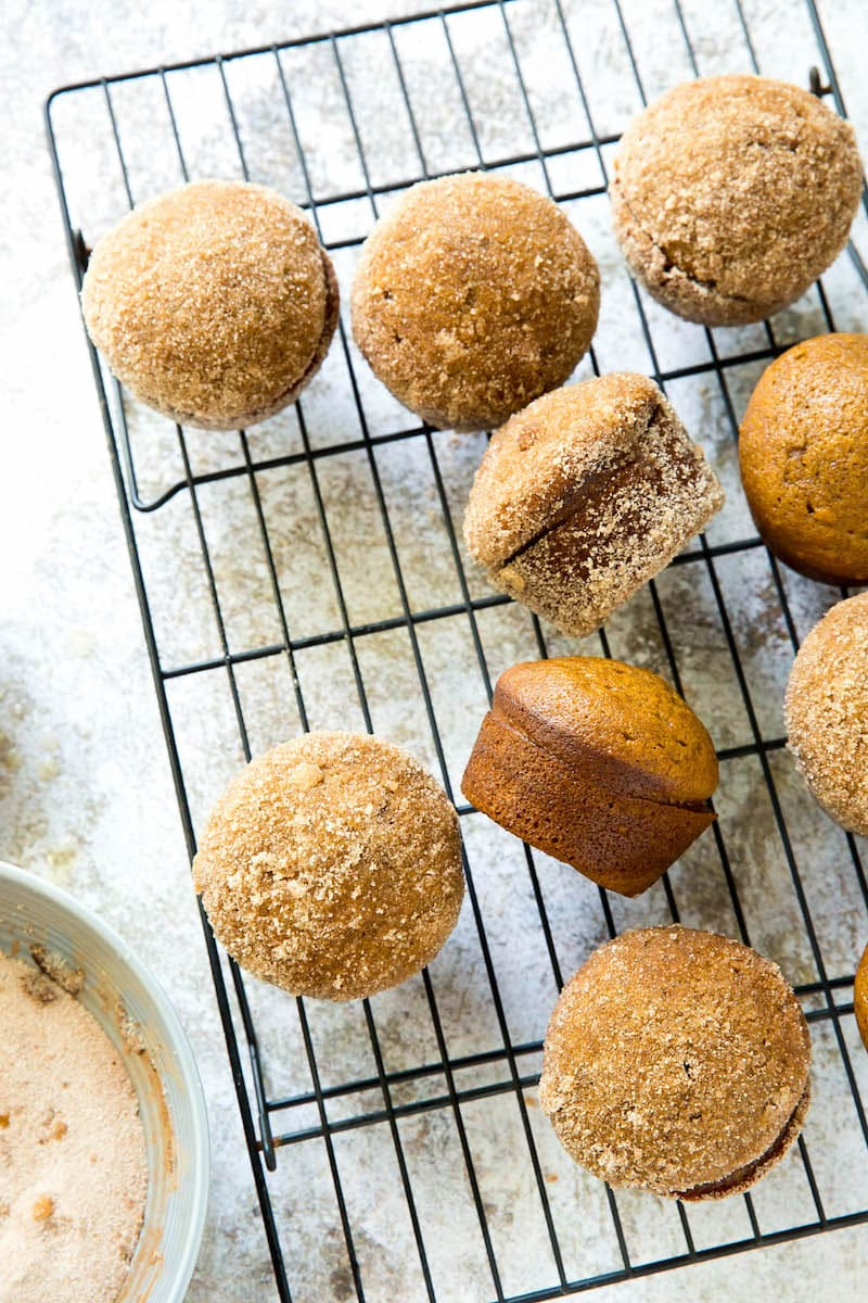 Donut Pumpkin Muffins on a cooling rack.