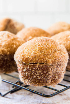 Donut Pumpkin Muffins topped with cinnamon sugar on a black rack