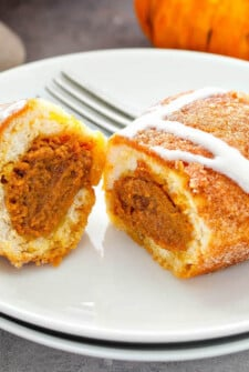 These sweet Pumpkin Pie Bombs are canned biscuits stuffed with pumpkin pie filling, baked with a cinnamon sugar topping and served with a cream cheese drizzle! #Pumpkin #PumpkinPie #PumpkinPieBombs #PumpkinRecipes #PumpkinDessert #Recipe #FallRecipes