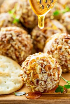 These creamy Honey Pecan Cheese Truffles are incredibly easy to make — just 15 minutes — and are my favorite make ahead holiday appetizers to impress my guests! #CheeseBalls #CheeseTruffles #HoneyPecanCheeseTruffles #Cheese #Appetizer #AppetizerRecipes #HolidayAppetizers #CheeseAppetizer #Recipe #CheeseBallRecipe