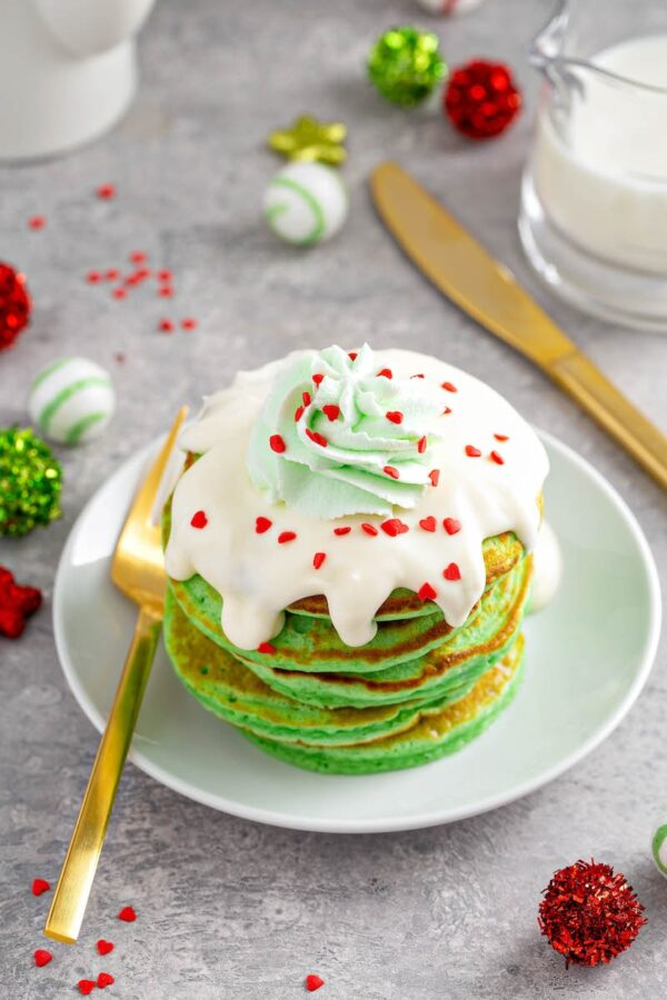 Copycat IHOP Grinch Pancakes on a plate with a gold fork.