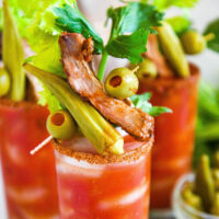 Bloody Mary recipe with garnishes on top.