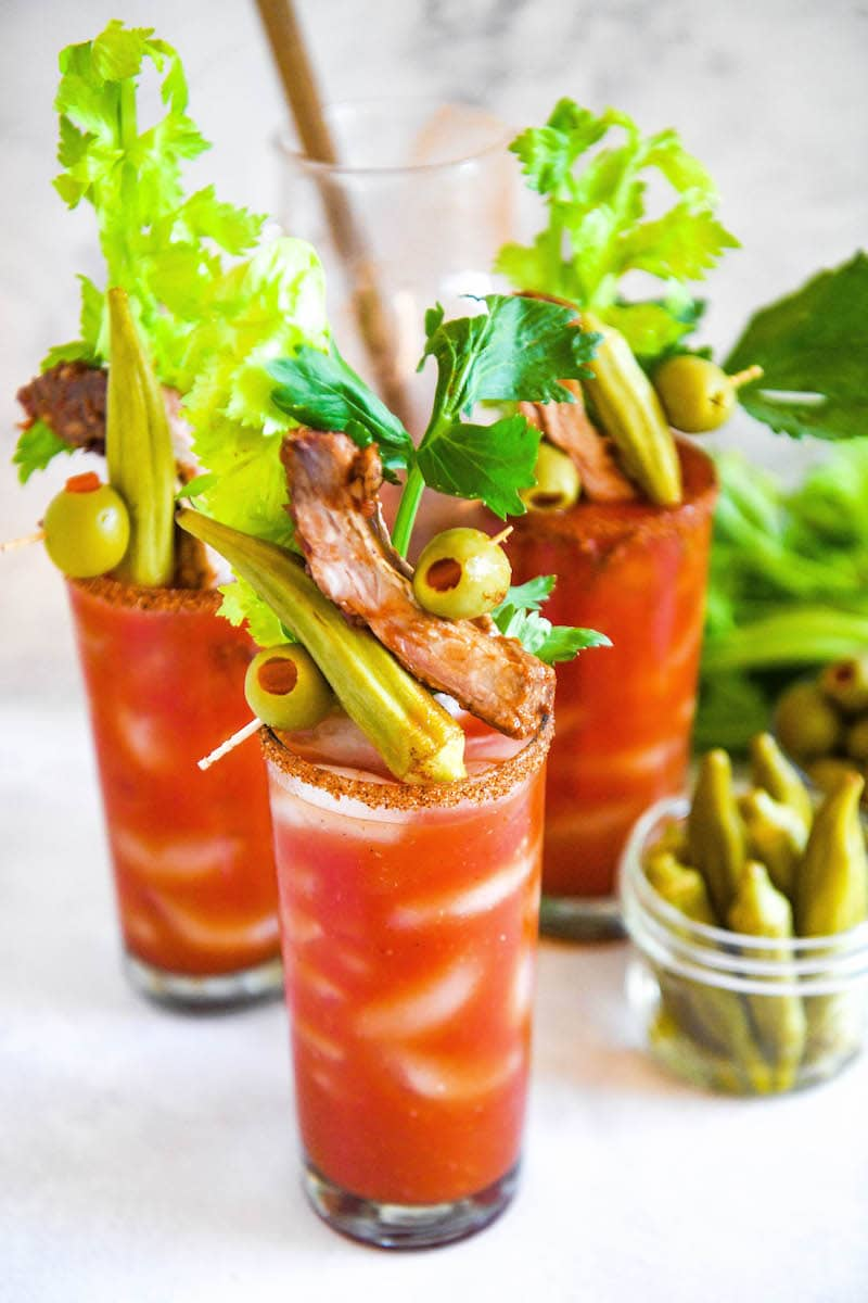 Homemade Bloody Mary Mix in a glass with celery.