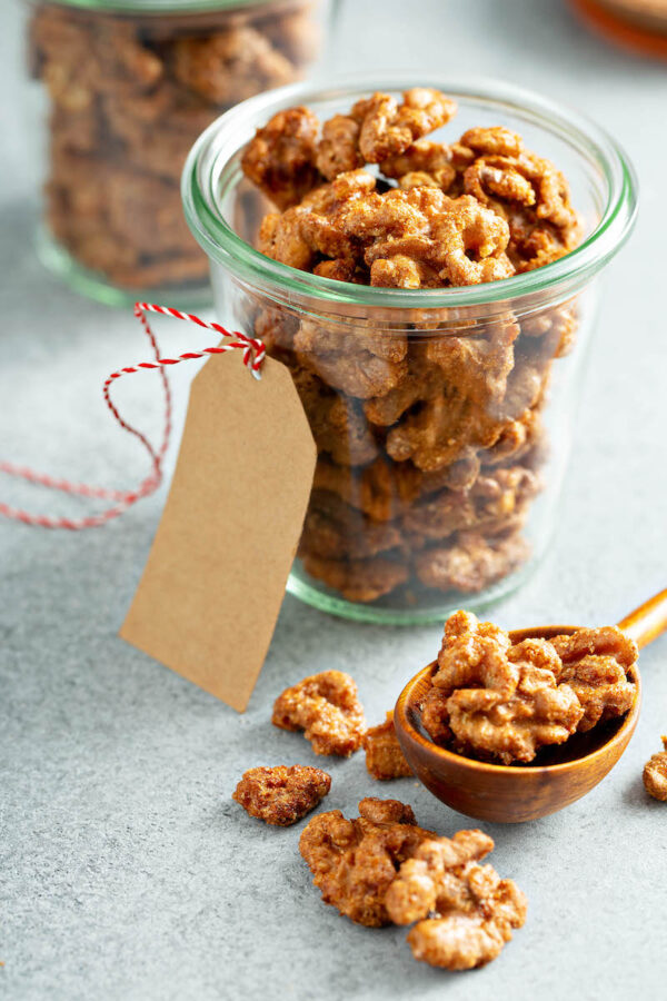 Toffee Walnuts in a glass jar with a gift tag.