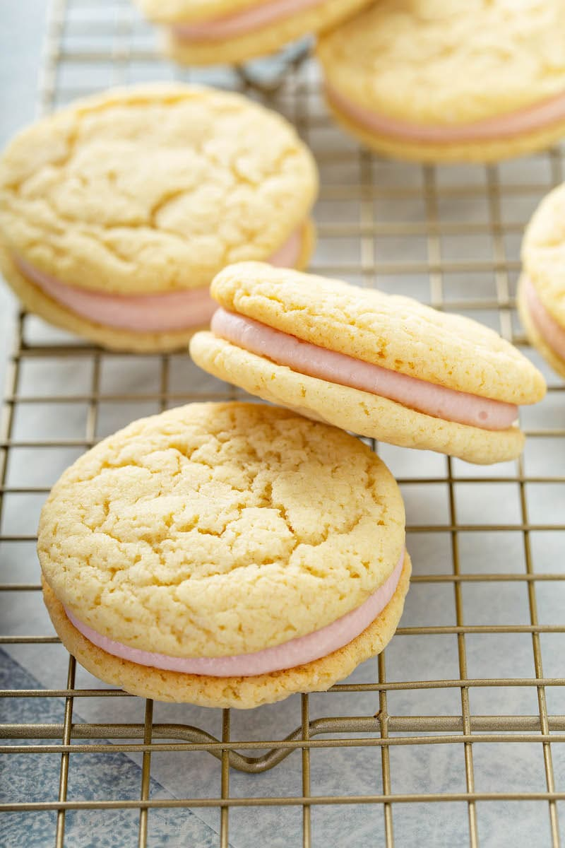 Sandwich cookies with raspberry buttercream in the center.
