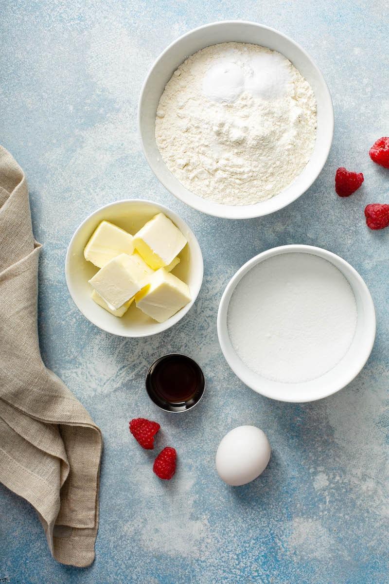Raspberry Sandwich Cookies Ingredients in white bowls.