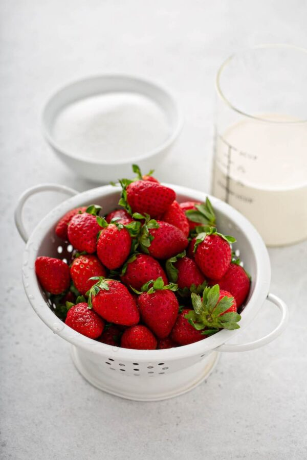 Strawberry Mousse Ingredients in white bowls.