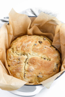 Irish Soda Bread in parchment paper and pot after baking.