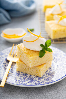 Slices of orange coconut cake on a blue plate.