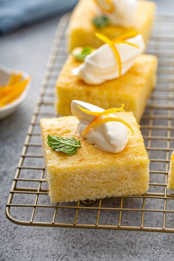 Orange Coconut Cake on a cooling rack.