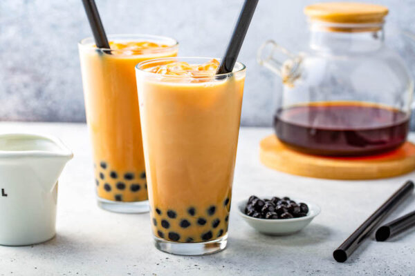 Boba Tea in a glass with tapioca pearls.